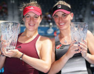 SYDNEY, AUSTRALIA - JANUARY 13:  Anastasia Pavlyuchenkova of Russia (L) and Tmea Babos of Hungary (R) pose with the winners trophies after defeating Sania Mirza of India and Barbora Strycova of Czech Republic in the Womens Doubles Final during the Sydney International at Sydney Olympic Park Tennis Centre on January 13, 2017 in Sydney, Australia.  (Photo by Matt King/Getty Images)